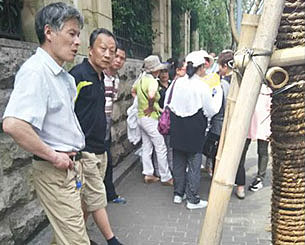 Supporters of democracy activists wait outside Zhejiang courthouse