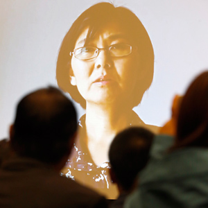 A photo of Chinese lawyer Wang Yu is seen on a screen during the first ABA International Human Rights Award ceremony at the ABA Annual Meeting in San Francisco