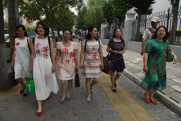 wives-of-chinese-human-rights-lawyers-detained-in-a-2015-crackdown-wearing-the-names-of-their-husbands