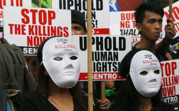 masked-protesters-gather-for-a-rally-near-the-presidential-palace-to-mark-international-human-rights-day-in-manila