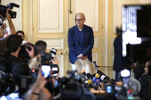 French writer Patrick Modiano poses for journalists after a news conference at the French publishing house Gallimard in Paris