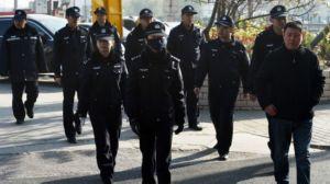 141121080347_police_patrol_at_gaoyu_trial_624x351_getty_nocredit