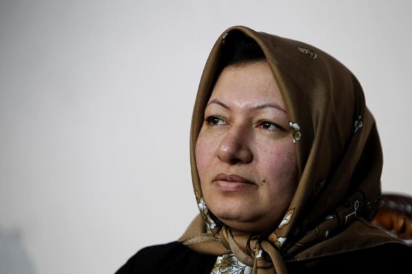 Sakineh Mohammadi Ashtiani, an Iranian woman sentenced to death by stoning for adultery, speaks during an interview with a group of journalists from international news networks at a guesthouse belonging to a government welfare organisation in Iran's northwestern city of Tabriz on January 1, 2011. The 43-year-old woman said that she would sue two German journalists who have been jailed in Iran for interviewing her son. AFP PHOTO/ATTA KENARE / AFP / ATTA KENARE