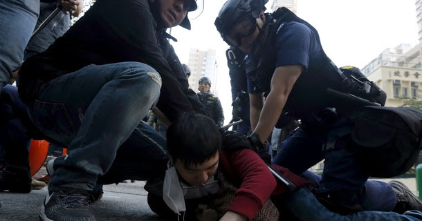 A protester is arrested by riot police at Mongkok district in Hong Kong, China February 9, 2016.      REUTERS/Bobby Yip - RTX262QW