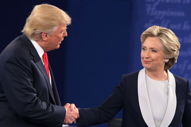 US Democratic presidential candidate Hillary Clinton and US Republican presidential candidate Donald Trump shake hands at the end of the second presidential debate at Washington University in St. Louis, Missouri, on October 9, 2016. / AFP / Tasos Katopodis        (Photo credit should read TASOS KATOPODIS/AFP/Getty Images)