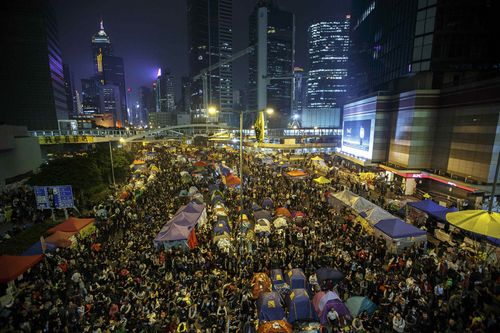 """Pro-democracy protesters gather at the Occupy Central protest site in Admiralty in Hong Kong December 10, 2014. Hong Kong urged pro-democracy protesters to pack up their tents and leave their main camp near government headquarters, saying it could not promise there would be no """"confrontations"""" when the site is cleared on Thursday. REUTERS/Athit Perawongmetha (CHINA - Tags: POLITICS CIVIL UNREST TPX IMAGES OF THE DAY)"""