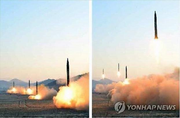 3月6日,朝军弹道导弹一字列阵,四箭齐发。(韩联社)