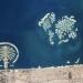 """宇航员在太空拍下的杜拜城和""""世界岛""""(右边是""""世界岛"""",左边是早已建成的""""棕榈岛"""")"""