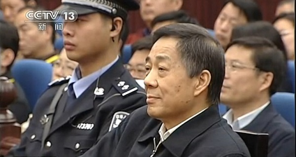 """This screen grab taken from CCTV footage released on October 25, 2013 shows fallen politician Bo Xilai (R) standing in the court room of Shandong High Court in Jinan, east China's Shandong province. The court on October 25 rejected Bo Xilai's appeal against his conviction and confirmed his life sentence, state media reported, a ruling likely to seal his fate as authorities look to close a damaging scandal.  AFP PHOTO / CCTV----EDITORS NOTE---- RESTRICTED TO EDITORIAL USE - MANDATORY CREDIT """"AFP PHOTO / CCTV - NO MARKETING NO ADVERTISING CAMPAIGNS - DISTRIBUTED AS A SERVICE TO CLIENTS"""
