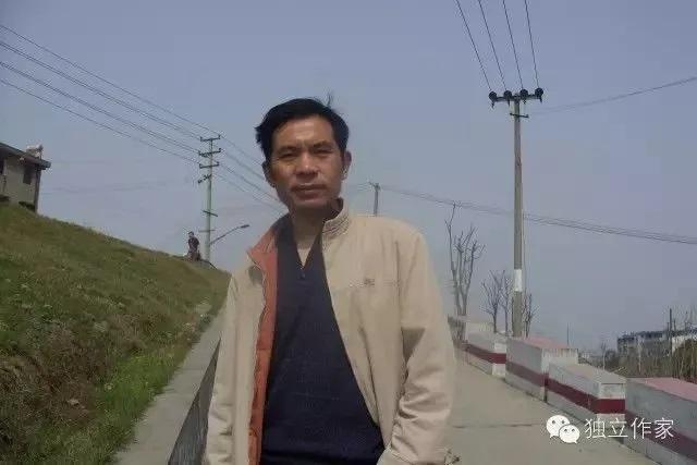 蓝冰:原名唐国庆